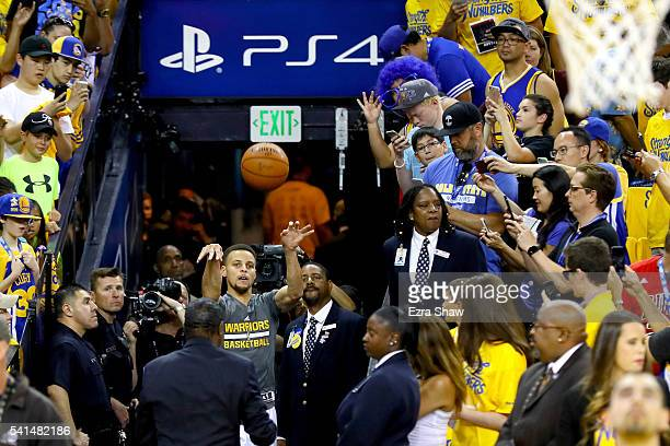 Stephen Curry of the Golden State Warriors shoots a shot from the tunnel and makes his first attempt before taking on the Cleveland Cavaliers in Game...