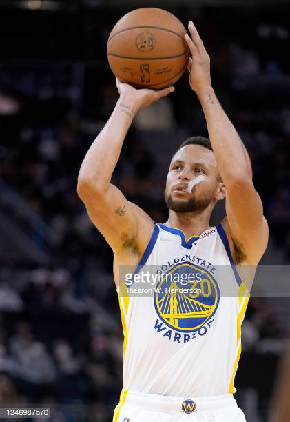 Stephen Curry of the Golden State Warriors shoots a technical foul shot against the Portland Trail Blazers during the second half of their game at...