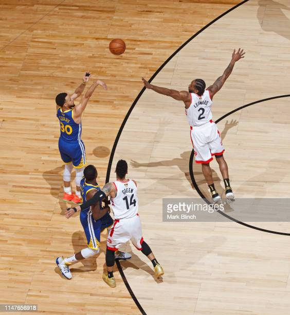Stephen Curry of the Golden State Warriors shoots a three point basket while guarded by Kawhi Leonard of the Toronto Raptors during Game Two of the...