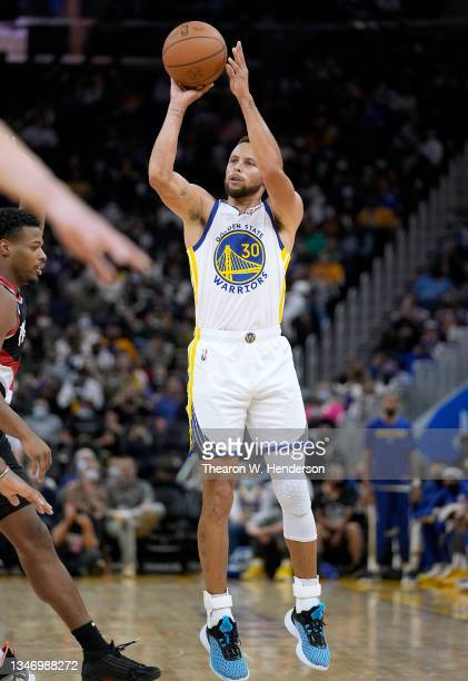 Stephen Curry of the Golden State Warriors shoots a three point shot against the Portland Trail Blazers during the second half of their game at Chase...