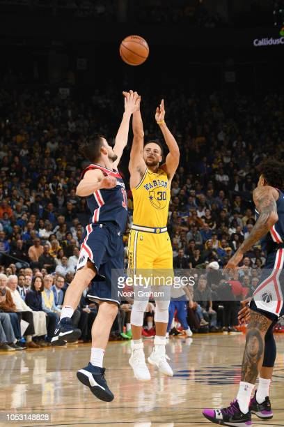 Stephen Curry of the Golden State Warriors shoots a three point basket against the Washington Wizards on October 24 2018 at ORACLE Arena in Oakland...
