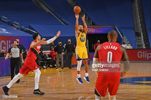 Stephen Curry of the Golden State Warriors shoots a three point basket against the Portland Trail Blazers on January 3, 2021 at Chase Center in San...