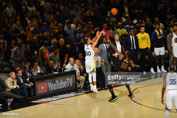 Stephen Curry of the Golden State Warriors shoots a three point basket against the Cleveland Cavaliers in Game Four of the 2018 NBA Finals on June 8...