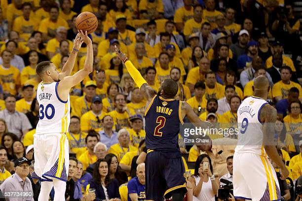 Stephen Curry of the Golden State Warriors shoots a three pointer over Kyrie Irving of the Cleveland Cavaliers in Game 1 of the 2016 NBA Finals at...