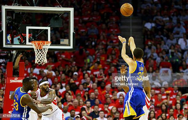 Stephen Curry of the Golden State Warriors shoots a three pointer to set the record for most three pointers in a post season in the second quarter...