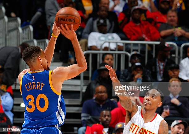 Stephen Curry of the Golden State Warriors shoots a threepoint basket against Jeff Teague of the Atlanta Hawks at Philips Arena on February 22 2016...