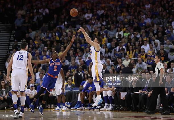 Stephen Curry of the Golden State Warriors shoots a threepoint basket over Langston Galloway of the New York Knicks at ORACLE Arena on March 16 2016...