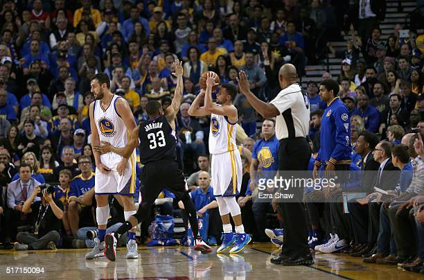 Stephen Curry of the Golden State Warriors shoots a threepoint basket over Wesley Johnson of the Los Angeles Clippers at ORACLE Arena on March 23...