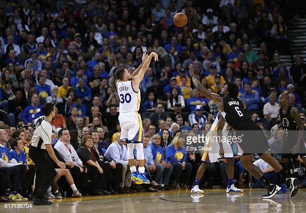 Stephen Curry of the Golden State Warriors shoots a threepoint basket over DeAndre Jordan of the Los Angeles Clippers at ORACLE Arena on March 23...