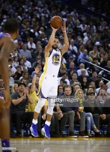 Stephen Curry of the Golden State Warriors shoots a threepoint basket against the New York Knicks at ORACLE Arena on January 23 2018 in Oakland...