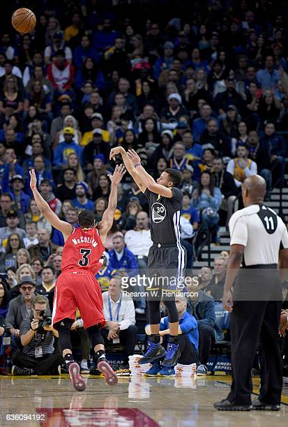 Stephen Curry of the Golden State Warriors shoots a threepoint shot over CJ McCollum of the Portland Trail Blazers during an NBA basketball game at...