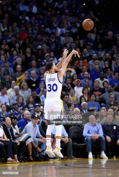 Stephen Curry of the Golden State Warriors shoots a threepoint shot against the Minnesota Timberwolves during an NBA basketball game at ORACLE Arena...