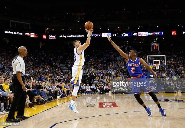 Stephen Curry of the Golden State Warriors shoots a threepointer over Langston Galloway of the New York Knicks at ORACLE Arena on March 16 2016 in...