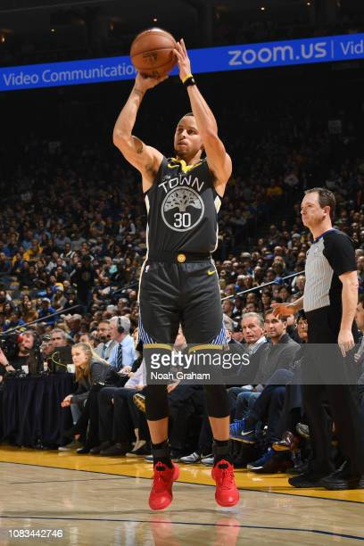 Stephen Curry of the Golden State Warriors shoots a threepointer against the New Orleans Pelicans on January 16 2019 at ORACLE Arena in Oakland...