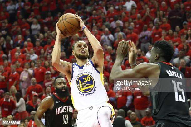 Stephen Curry of the Golden State Warriors shoots against Clint Capela of the Houston Rockets in the third quarter of Game Two of the Western...