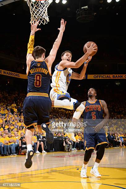 Stephen Curry of the Golden State Warriors shoots against Matthew Dellavedova of the Cleveland Cavaliers during Game Five of the 2015 NBA Finals at...