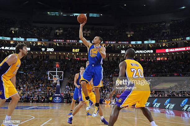 Stephen Curry of the Golden State Warriors shoots against Steve Nash of the Los Angeles Lakers during the 2013 Global Games on October 15 2013 at the...