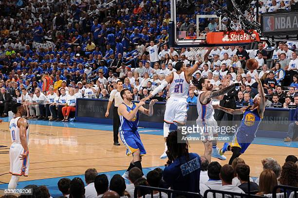 Stephen Curry of the Golden State Warriors shoots against Steven Adams of the Oklahoma City Thunder in Game Three of the Western Conference Finals...