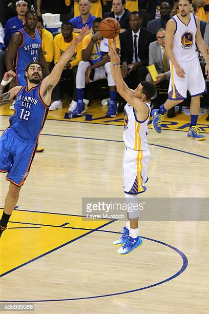 Stephen Curry of the Golden State Warriors shoots against Steven Adams of the Oklahoma City Thunder in Game Seven of the Western Conference Finals...