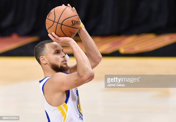 Stephen Curry of the Golden State Warriors shoots against the Cleveland Cavaliers during Game Three of the 2018 NBA Finals at Quicken Loans Arena on...