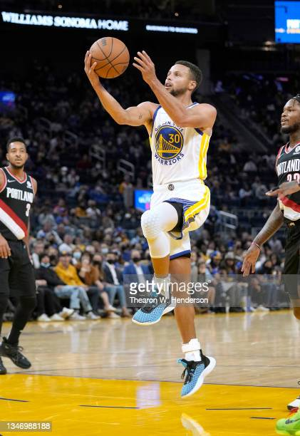 Stephen Curry of the Golden State Warriors shoots against the Portland Trail Blazers during the second half of their game at Chase Center on October...