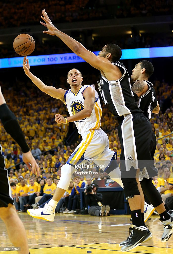 Stephen Curry #30 of the Golden State Warriors shoots against Tim Duncan #21 of the San Antonio Spurs in Game Six of the Western Conference Semifinals during the 2013 NBA Playoffs on May 16, 2013 at the Oracle Arena in Oakland, California. The Spurs won 94-82 to take the series 4-2. .