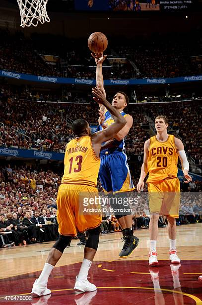 Stephen Curry of the Golden State Warriors shoots against Tristan Thompson of the Cleveland Cavaliers during Game Three of the 2015 NBA Finals at The...
