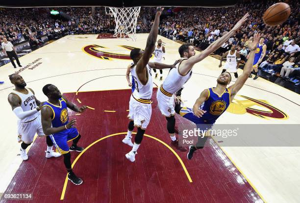 Stephen Curry of the Golden State Warriors shoots against Tristan Thompson and Kevin Love of the Cleveland Cavaliers in the second half in Game 3 of...