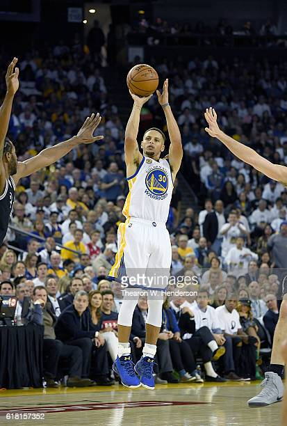 Stephen Curry of the Golden State Warriors shoots and scores a three point basket against the San Antonio Spurs during the second quarter in an NBA...