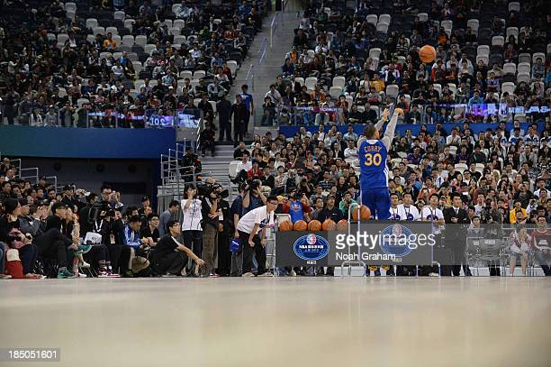 Stephen Curry of the Golden State Warriors shoots during Fan Appreciation Day as part of the 2013 Global Games on October 17 2013 at the Oriental...