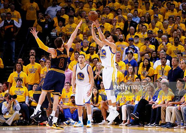 Stephen Curry of the Golden State Warriors shoots for three against Matthew Dellavedova of the Cleveland Cavaliers in the fourth quarter during Game...