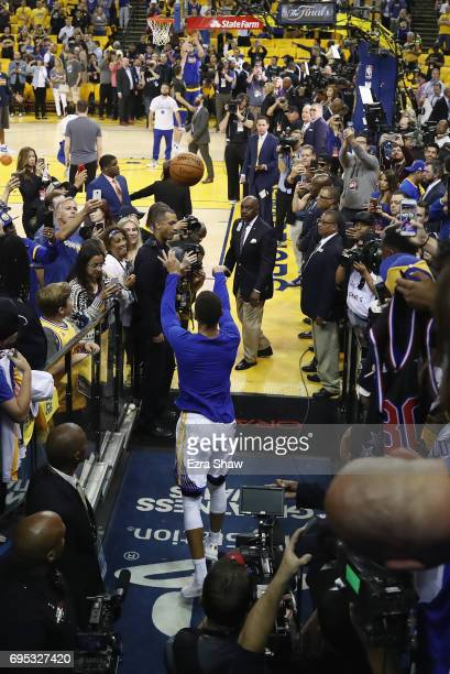 Stephen Curry of the Golden State Warriors shoots from the tunnel during warmups prior to Game 5 of the 2017 NBA Finals at ORACLE Arena on June 12...