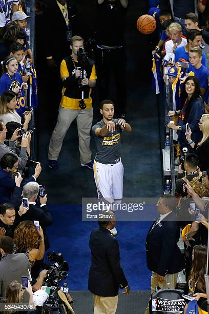 Stephen Curry of the Golden State Warriors shoots from the tunnel prior to Game Five of the Western Conference Finals against the Oklahoma City...