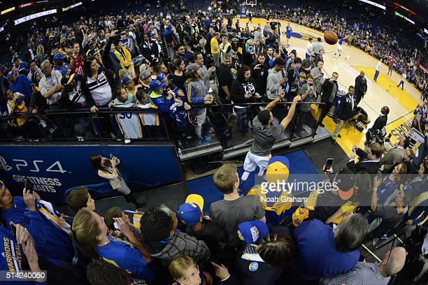 Stephen Curry of the Golden State Warriors shoots his traditional pregame tunnel shot before facing the Orlando Magic on March 7 2016 at Oracle Arena...