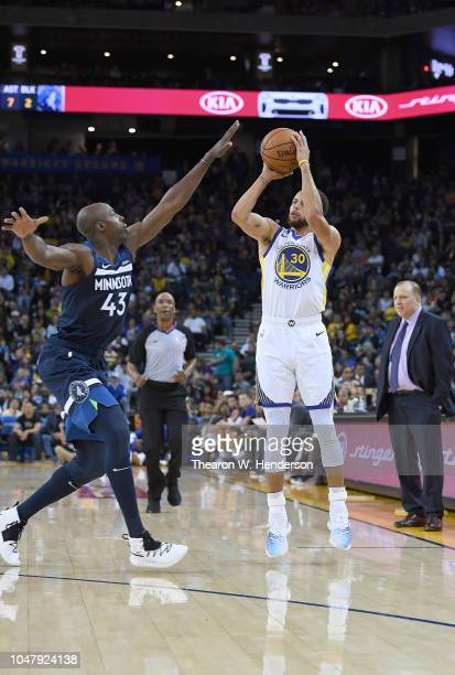 Stephen Curry of the Golden State Warriors shoots over Anthony Tolliver of the Minnesota Timberwolves during an NBA basketball game at ORACLE Arena...