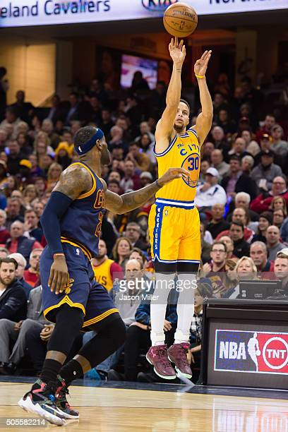 Stephen Curry of the Golden State Warriors shoots over LeBron James of the Cleveland Cavaliers during the first half at Quicken Loans Arena on...