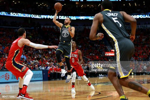 Stephen Curry of the Golden State Warriors shoots over Nikola Mirotic of the New Orleans Pelicans during the second half of Game Three of the Western...