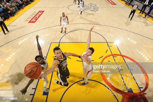 Stephen Curry of the Golden State Warriors shoots the ball against the LA Clippers on December 23 2018 at ORACLE Arena in Oakland California NOTE TO...