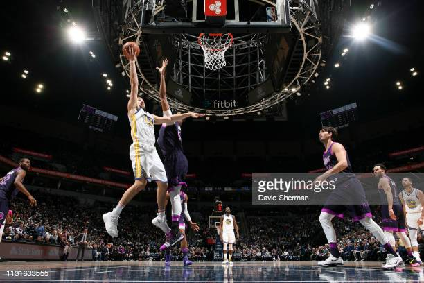 Stephen Curry of the Golden State Warriors shoots the ball against the Minnesota Timberwolves on March 19 2019 at Target Center in Minneapolis...