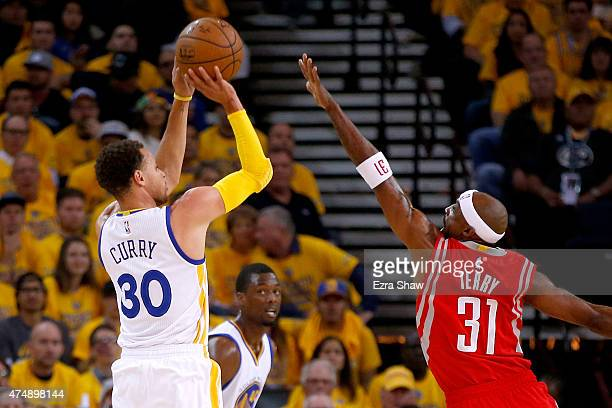 Stephen Curry of the Golden State Warriors shoots the ball against Jason Terry of the Houston Rockets in the first half during game five of the...