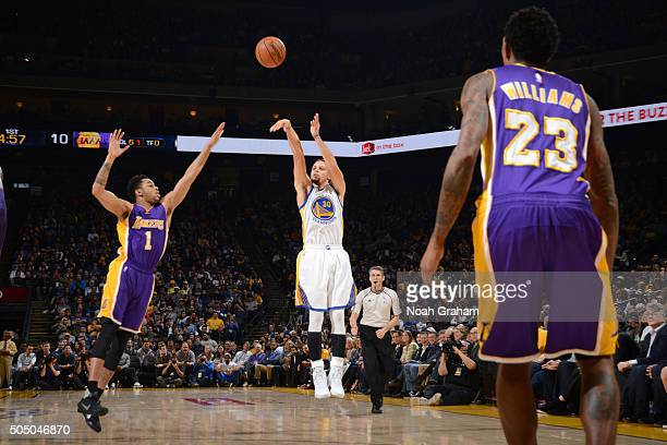 Stephen Curry of the Golden State Warriors shoots the ball against the Los Angeles Lakers on January 14 2016 at ORACLE Arena in Oakland California...