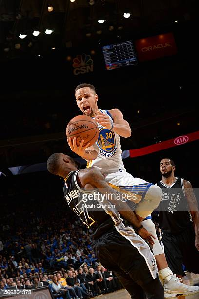Stephen Curry of the Golden State Warriors shoots the ball against the San Antonio Spurs on January 25 2016 at ORACLE Arena in Oakland California...