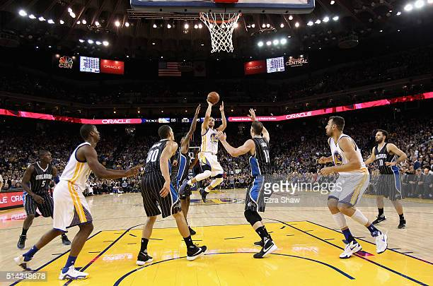 Stephen Curry of the Golden State Warriors shoots the ball against the Orlando Magic at ORACLE Arena on March 7 2016 in Oakland California NOTE TO...