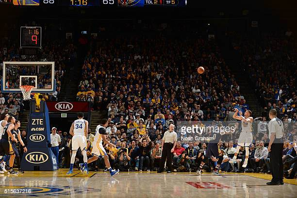 Stephen Curry of the Golden State Warriors shoots the ball against the New Orleans Pelicans on March 14 2016 at ORACLE Arena in Oakland California...