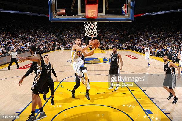 Stephen Curry of the Golden State Warriors shoots the ball against the San Antonio Spurs on April 7 2016 at ORACLE Arena in Oakland California NOTE...