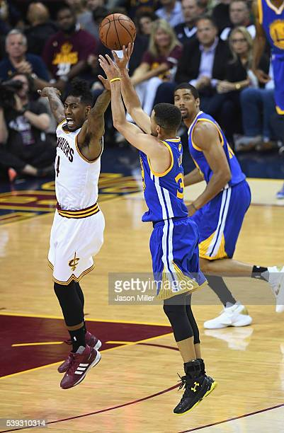 Stephen Curry of the Golden State Warriors shoots the ball against Iman Shumpert of the Cleveland Cavaliers during the first half in Game 4 of the...