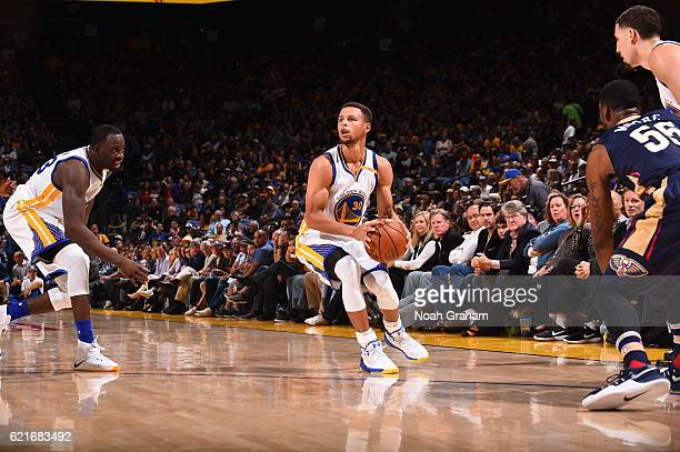 Stephen Curry of the Golden State Warriors shoots the ball against the New Orleans Pelicans on November 7 2016 at ORACLE Arena in Oakland California...