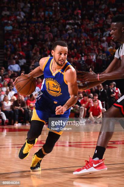 Stephen Curry of the Golden State Warriors shoots the ball against the Houston Rockets on March 28 2017 at the Toyota Center in Houston Texas NOTE TO...