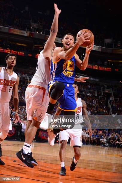 Stephen Curry of the Golden State Warriors shoots the ball against the Phoenix Suns on April 5 2017 at Talking Stick Resort Arena in Phoenix Arizona...
