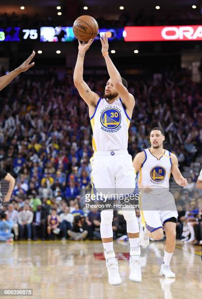Stephen Curry of the Golden State Warriors shoots the ball against the Minnesota Timberwolves during an NBA basketball game at ORACLE Arena on April...